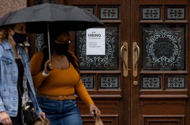 A 'we are hiring' hangs in the window of a pub seeking bar and kitchen staff in London on June 4th. Photograph: Rob Pinney/Getty