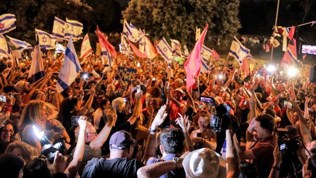Israelis celebrate the passing of a vote confirming a new coalition government during a rally in front of the Knesset during a parliamentary vote, in Jerusalem on June 13th. Photograph: Menahem Kahana/ AFP via Getty
