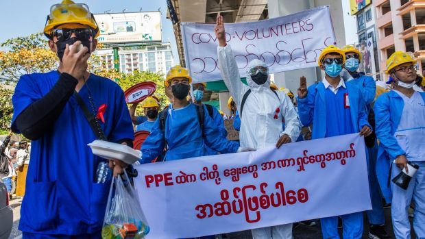Healthcare workers wearing red ribbons, symbolising opposition to Myanmar's military coup, in Yangon in February. Photograph: The New York Times