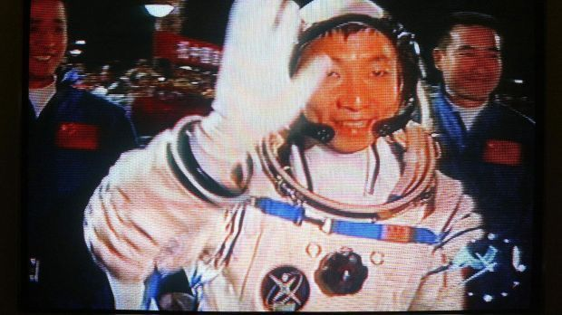Chinese astronaut Yang Liwei pictured on TV waving as he heads to board the Shenzhou V spacecraft on a Long March CZ-2F rocket, on October 15th, 2003, at the Jiquan Launch Center in northwest China. Photograph: AFP via Getty Images