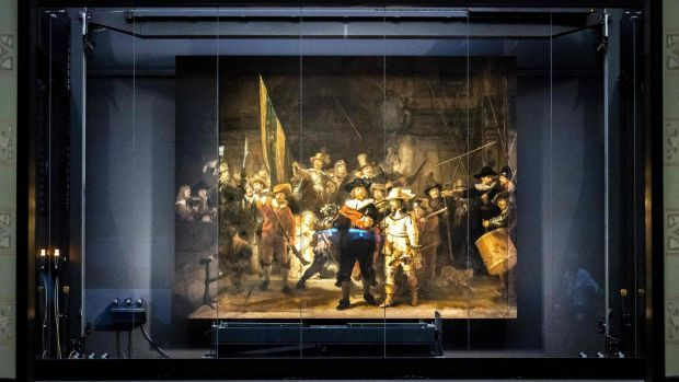 The Night Watch remounted at the Rijksmuseum. Photograph: Remko De Waal/ANP/AFP via Getty Images