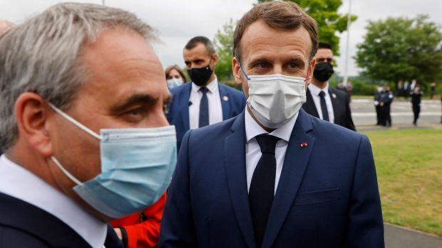 French president Emmanuel Macron with the president of the northern France Hauts-de-France region, Xavier Bertrand, before a visiting to a car factor in Douai this week. Photgraph: Ludovic Marin/POOL/AFP via Getty Images
