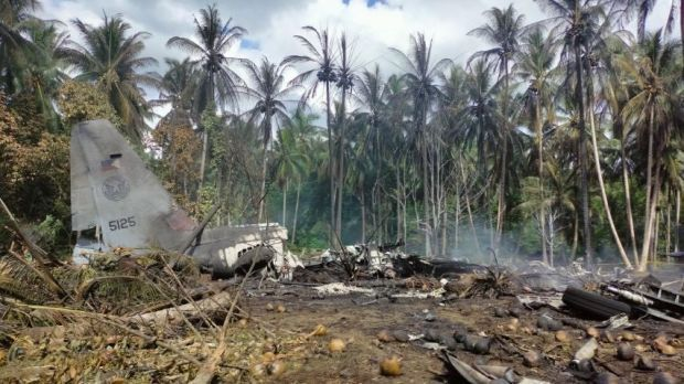 Debris from the crashed Air Force C-130 cargo plane. Photograph: Joint Task Force Jolo-Armed Forces/EPA