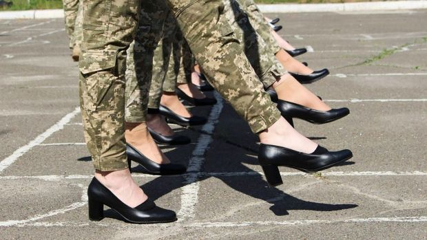 The heels are part of the female cadets' dress uniform worn for formal occasions, but such shoes are not worn with field uniforms. Photograph: Ukrainian defence ministry press/AFP via Getty Images