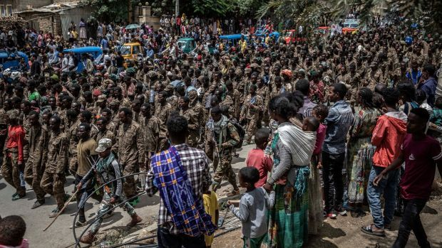 Crowds watch as captured Ethiopian government soldiers are marched through Mekelle on July 2nd. Photograph: Finbarr O'Reilly/The New York Times