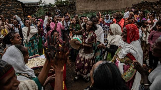 People celebrate in the town of Gijet as Tigray Defence Forces soldiers and leaders departed for Mekelle. Photograph: Finbarr O'Reilly/The New York Times