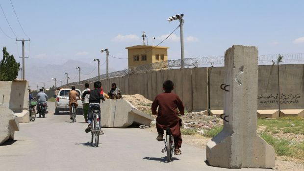 Children ride bicycles past a road checkpoint outside Bagram air base, some 70km north of Kabul, after all US and Nato troops left. Photograph: Zakeria Hashimi/AFP via Getty Images