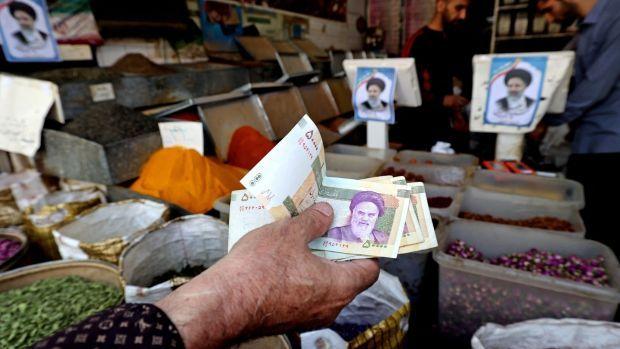 Iranians shop at the Molavi bazaar in southern Tehran. Photograph: Atta Kenare/AFP via Getty Images