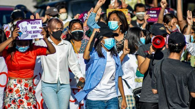 Women protesters make the three-finger salute as they take part in a demonstration against the military coup in Mandalay last week. Photograph: AFP via Getty Images
