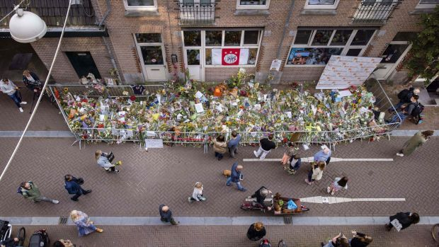 People lay flowers for murdered Dutch crime journalist Peter R de Vries at the back of the Lange Leidsedwarsstraat street in the centre of Amsterdam on July 15th. Photograph: Ramon van Flymen/ANP/AFP via Getty
