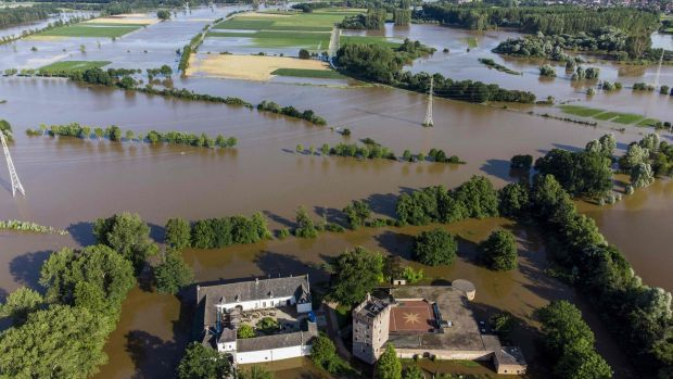 This aerial view taken in Herkenbosch, near Roermond, on Saturday shows Castle Daelenbroeck surrounded by flood waters near the river Roer. Photograph: AFP