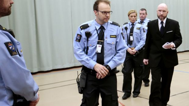 Anders Behring Breivik, escorted by police officers, enters the courtroom on the third day of his appeal case in Borgarting Court of Appeal at Telemark prison in Skien, on January 12th, 2017. Photograph: Photograph: Lise Aaresud/AFP via Getty Images