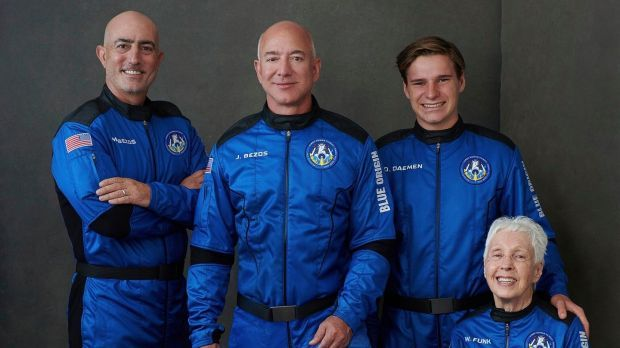 From left to right: Mark Bezos, brother of Jeff Bezos; Jeff Bezos, founder of Amazon and space tourism company Blue Origin; Oliver Daemen, of the Netherlands; and Wally Funk, aviation pioneer from Texas, pose for a photo. Photograph: Blue Origin via AP