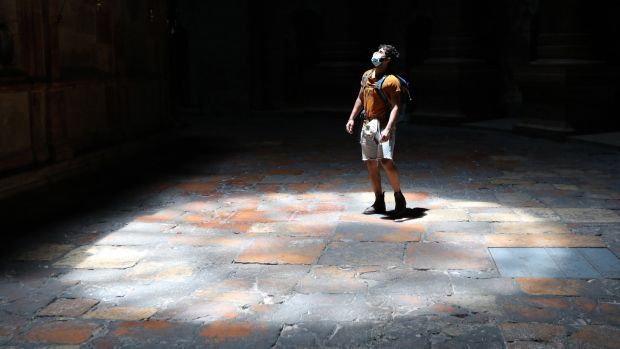A visitor wearing a face mask stands inside the Church of the Holy Sepulchre in the Old City of Jerusalem on July 15th. Photograph: Abir Sultan/EPA