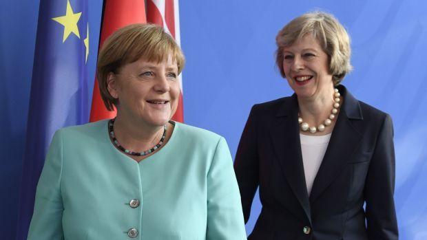 Angela Merkel and Theresa May. Photograph: John MacDougall/AFP/Getty