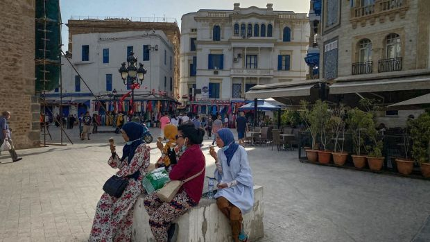 People eat ice cream in a square near the old markets in Tunis. Photograph: Sima Diab/The New York Times