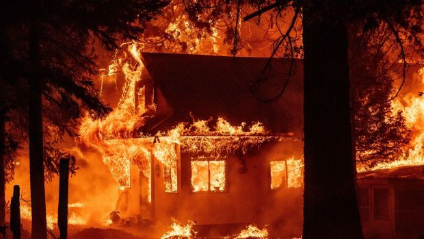 A home burns during the Dixie Fire in California this week – just 32km from the town of Paradise. Photograph: Josh Edelson/AFP via Getty Images
