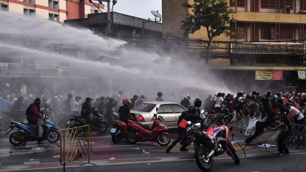 Police fire water cannon at pro-democracy protesters in Bangkok on Tuesday. Photograph: Lillian Suwanrumpha/AFP via Getty Images