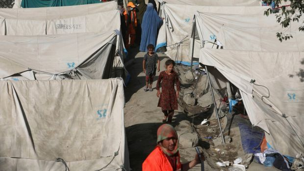 Internally displaced Afghans from northern provinces take refuge in a public park in Kabul. Photograph: Rahmat Gul/AP