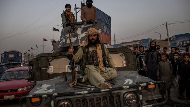 Taliban fighters on a 4x4 in Kabul, Afghanistan. Photograph: Jim Huylebroek/The New York Times
