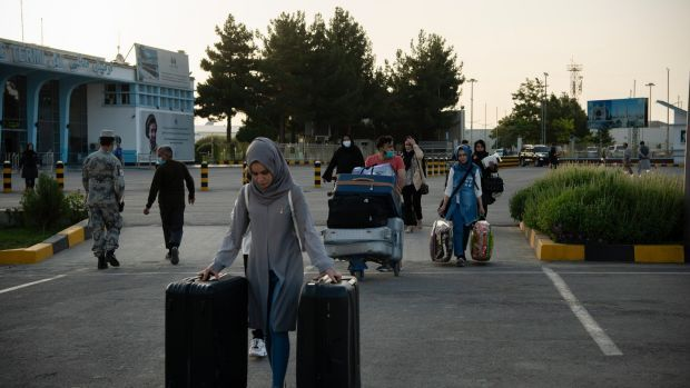 People pass through checkpoints at the Hamid Karzai International Airport in Kabul ahead of the Taliban's arrival, where one resident described seeing women crying by the side of the road, desperately trying to get a ride home and to barricade their doors. Photograph: Jim Huylebroek/The New York Times