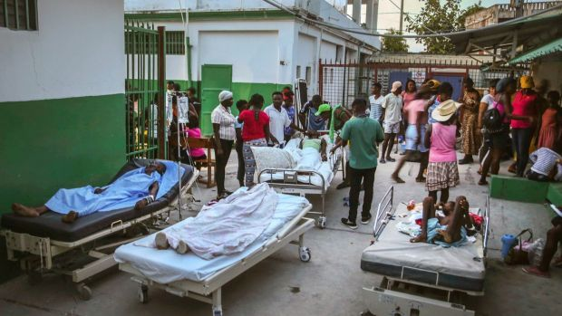 People injured during the earthquake are treated in the hospital in Les Cayes, Haiti. Photograph: Joseph Odelyn/AP