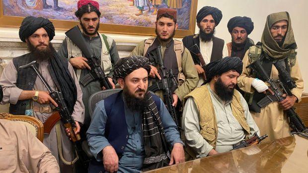 Taliban fighters in the presidential palce in Kabul on Sunday night. Photograph: Zabi Karimi/AP