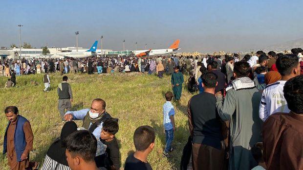 Afghans crowd at Kabul airport. Photograph: Shakib Rahmani/AFP via Getty Images