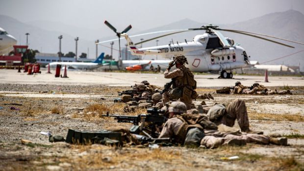 A handout image from the US Marine Corps shows marines providing security at Hamid Karzai International Airport in Kabul, Afghanistan. Photograph: AP