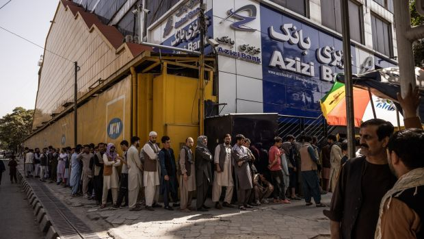 People queue outside a bank in Kabul on Sunday. Photograph: Jim Huylebroek/The New York Times