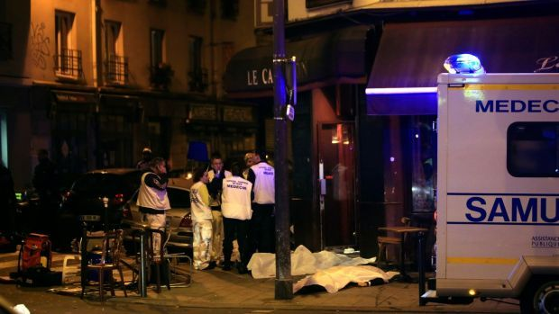 Medics stand by victims in a Paris restaurant, on Friday, November 13th, 2015. Photograph: Thibault Camus/File/AP Photo