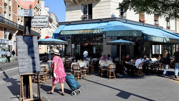 Customers sit on the terrace of the former Comptoir Voltaire, where a jihadist set off his explosive belt on November 13th, 2015. Photograph: Thomas Coex/AFP via Getty