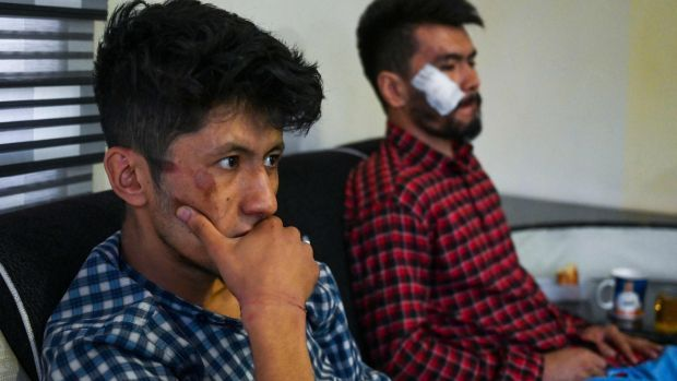 Afghan journalists Neamat Naqdi (R) and Taqi Daryabi sit in their office after being released from Taliban custody in Kabul. Photograph: Wakil Kohsar/AFP via Getty Images