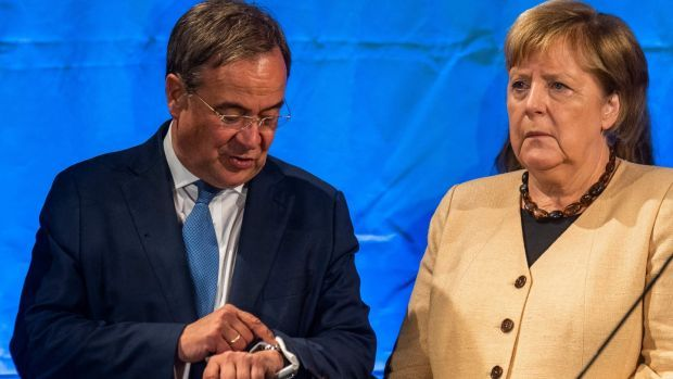 Armin Laschet (L), chairman and chancellor candidate of Germany's conservative Christian Democratic Union (CDU) party, as Angela Merkel looks on during an election campaign meeting. Photograph: John MacDougall/AFP via Getty Images