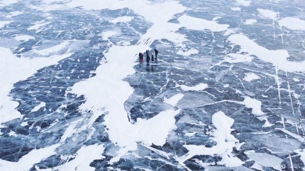 Tourists enjoy a walk on Lake Baikal. Photograph: Natalia Fedosenko/ Tass via Getty