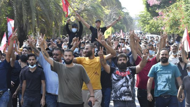 Hundreds of Hizbullah and Amal Movement supporters during a rally in Beirut on Thursday. Six people were killed after snipers opened fire on the protesters. Photograph: Hussam Shbaro/Anadolu Agency via Getty Images
