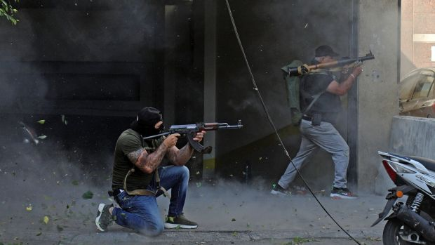 Shia fighters from Hizbullah and the Amal Movement during clashes in the Tayouneh suburb of Beirut on Thursday. Photograph: Ibrahim Amro/AFP via Getty Images