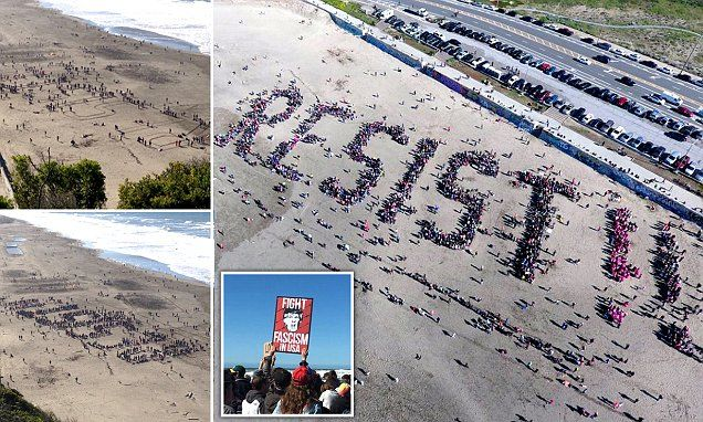 Anti-Trump protesters spell out 'RESIST!!' on San Francisco beach