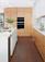 A Mid Century Modern Kitchen With A Creative Storage