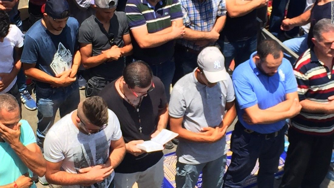 Christian man prays with Jerusalem Muslims as religious tensions flare