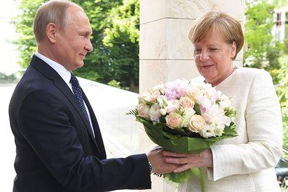 Меркель приехала к Путину и перешла на русский