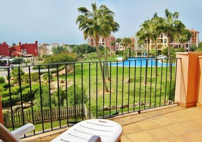 Very well maintained and furnished duplex ground floor apartment in high quality residence in Nova Santa Ponsa next to the golf course with large and private