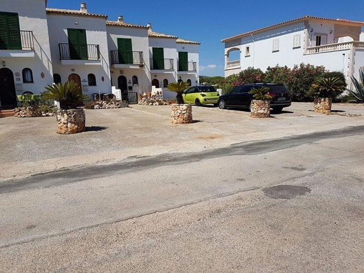 Beautiful semi-detached house with community garden and swimming pool in Cala Murada