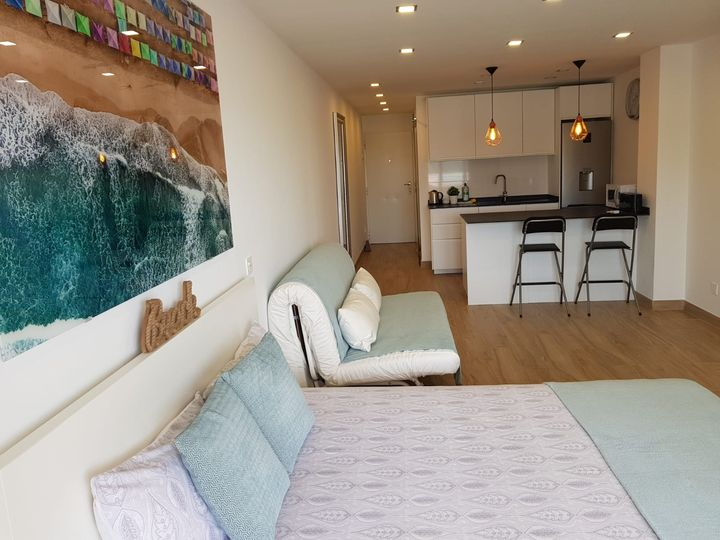 This studio in popular wave house impresses with its modern renovation including a stunning kitchen and bathroom