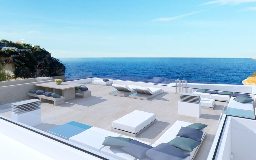 In first line to the sea is this modern villa in Port Adriano