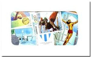 SWIMMING -  100 ASSORTED STAMPS - SWIMMING