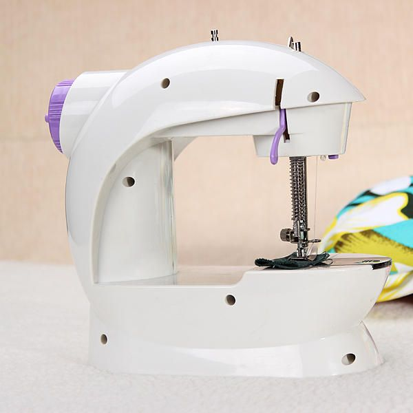 OST US$33.99 Portable Home Handwork Electric Mini Sewing Machine With Led Light