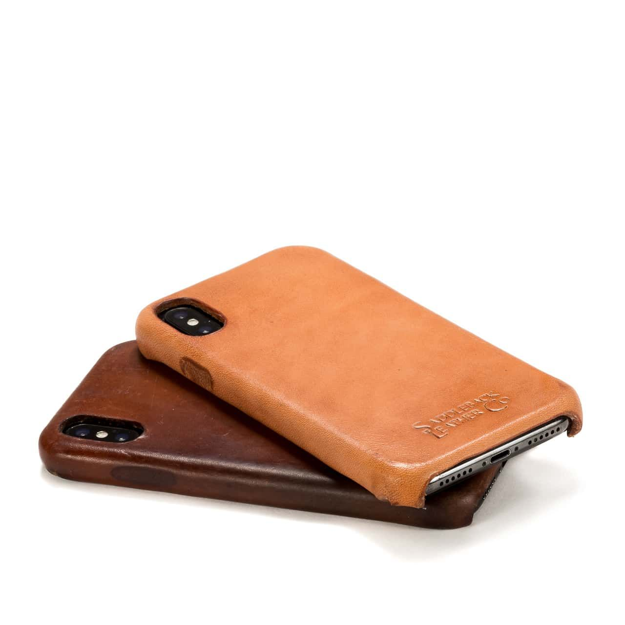 New and Patina'd Boot Leather iPhone Case lying down stair stacked