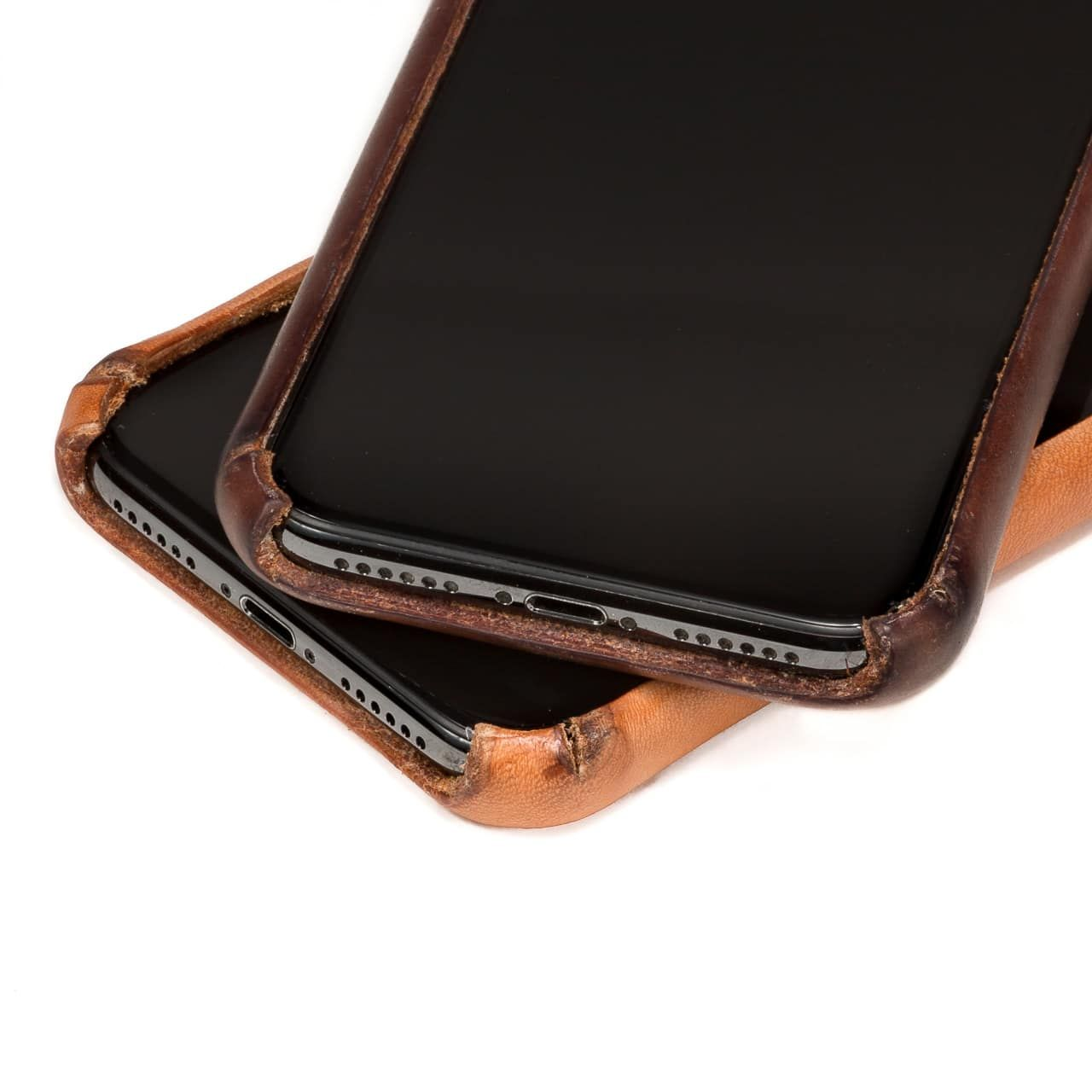 New and Patina'd Boot Leather iPhone Case Front Zoomed on the bottom with exhaust ports and power input
