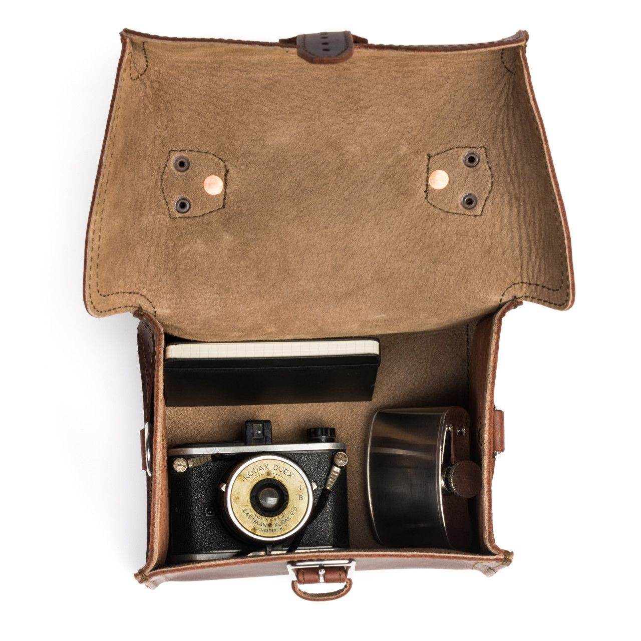 For your most valuable souvenirs suitcase will be leather gadget bag medium in chestnut leather